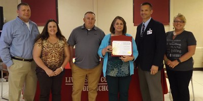 Ms. Tina Lawless Live RED award recipient for the month of April.  Ms. Lawless is pictured with members of the Livingston County Board of Education and was presented with a certificate and will have lunch delivered.